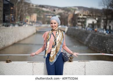 young woman posing on bridge