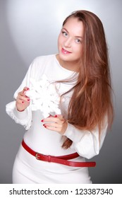 Young woman posing on camera with white snowflake on Holiday theme