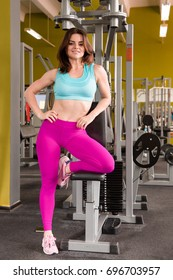 Young woman posing on gym in sport hall