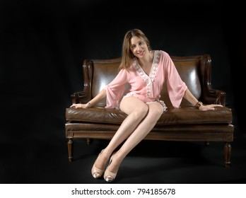 young woman posing on sofa