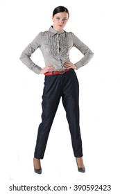 Young woman posing in strict trousers and shirt. White background.