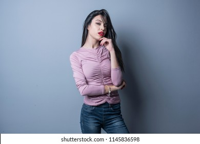 Young woman posing in studio shot with sexy expression looking at camera