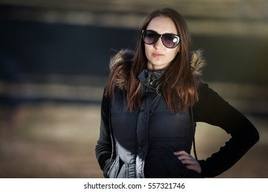 Young woman posing with sunglasses