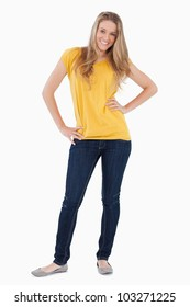 Young woman posing with a yellow shirt against white background