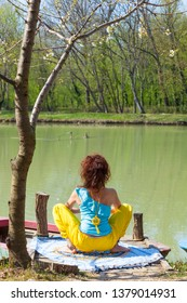 young woman practice yoga outdoor by the lake healthy lifestyle concept back view full body shot