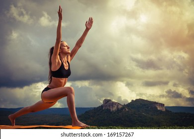 Young woman practiced surya namaskar yoga poses sequence