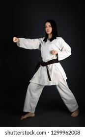 Young Woman Practicing with Karate Martial Art