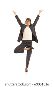 Young woman practicing yoga in a business suit