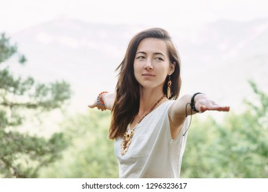 Young woman practicing yoga lesson, standing in Warrior two exercise, Virabhadrasana II pose