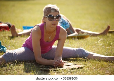 Young woman is practicing yoga outdoors