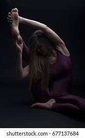 Young woman practicing yoga in the studio