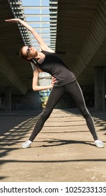Young woman practises exercise outdoors