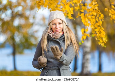 Young woman practising self defence outdoor in autumn