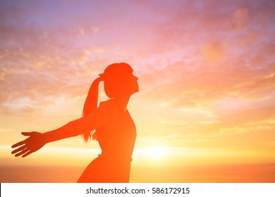 young woman pray pious with sunrise, asian
