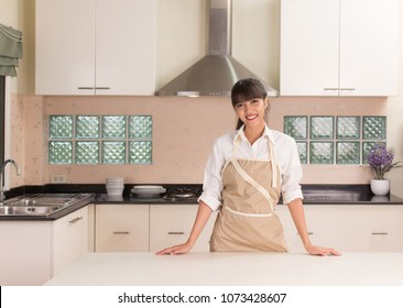 Young woman preparing to cooking in the modern kitchen style