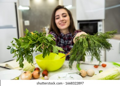 Young woman preparing dinner in a kitchen. healthy lifestyle.