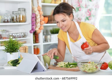 young woman preparing dinner on kitchen