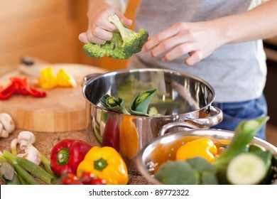 Young woman preparing healthy dinner