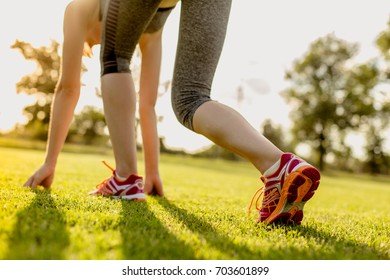 Young woman is preparing to run, training concept