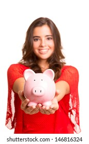 Young woman presenting a piggy bank (money box) - savings concept