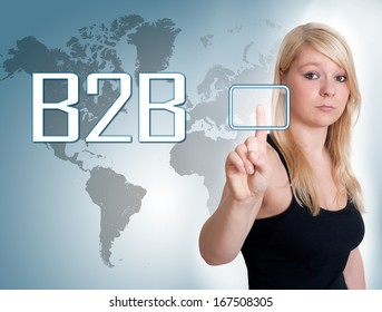 Young woman press digital Business to Business button on interface in front of her