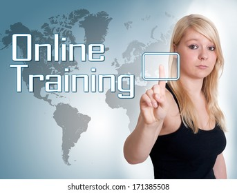 Young woman press digital Online Training button on interface in front of her