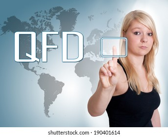Young woman press digital Quality Function Deployment button on interface in front of her