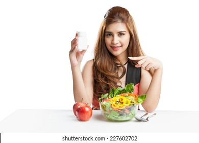 Young woman pretty attractive presenting blank bottle supplementary food compare with salad. Portrait of beautiful happy mixed Asian brunette woman enjoying a healthy salad and cherry tomatoes snack