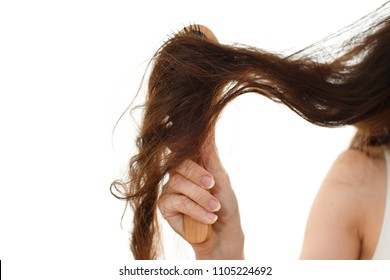 Young woman with problem hair. White background