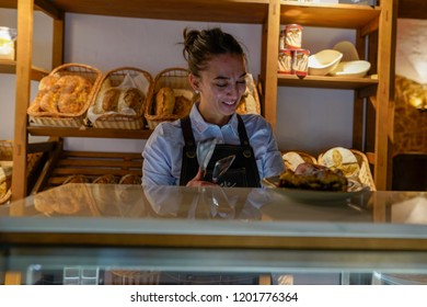 young woman professional working in bakery