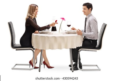 Young woman proposing to her boyfriend at a restaurant table isolated on white background