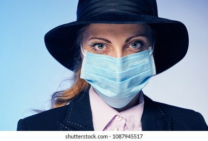 Young woman in a protective mask. She protects herself