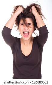 young woman pulling her hair and screaming