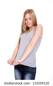Young woman pulling her shirt over white background