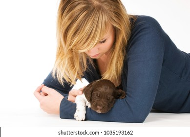 Young woman with puppy isolated on white background
