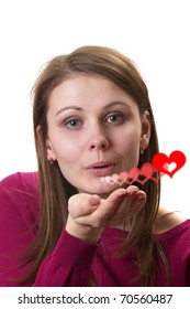 Young woman in purple sweater gesturing air kiss isolated over white background (heart illustration)