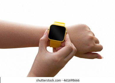 Young woman put button on yellow smartwatch isolated on white background