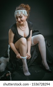 Young woman puts on white stockings