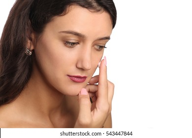 Young woman putting face cream - studio shoot, white background