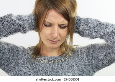 young woman putting her hands over her ears