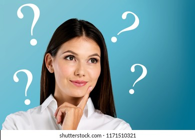 Young woman with question marks