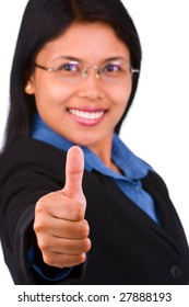 A young woman raise her thumb up, focus on the thumb.