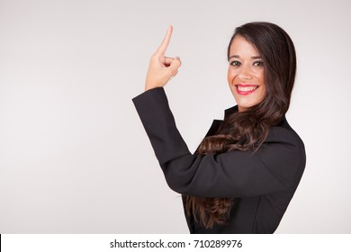 Young woman raises a finger