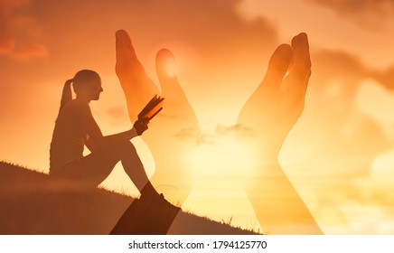 Young woman reading the Bible and praying hands. Religious belief, and salvation concept.