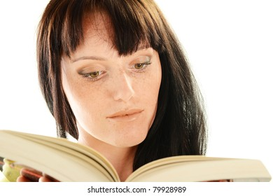 Young woman reading a book isolated on white. Female student learning