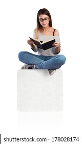 young woman reading a book sitting on a white placard