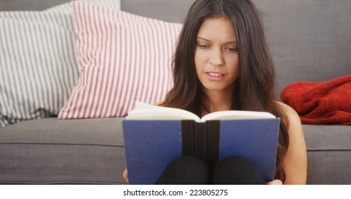 Young woman reading a good book