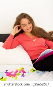 young woman reading in her bedroom