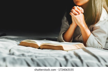 Young woman reading the holy bible in morning, worship and pray.devotion concept.