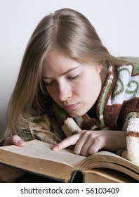 Young woman reads the book